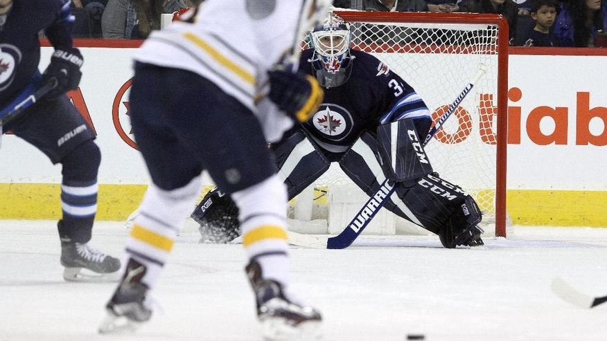 Buffalo Sabres forward Kyle Okposo winds up to shoot on Winnipeg Jets goaltender Michael Hutchinson (34) during second period NHL hockey action in Winnipeg, Manitoba, Sunday, Oct. 30, 2016. (Jason Halstead/The Canadian Press via AP)