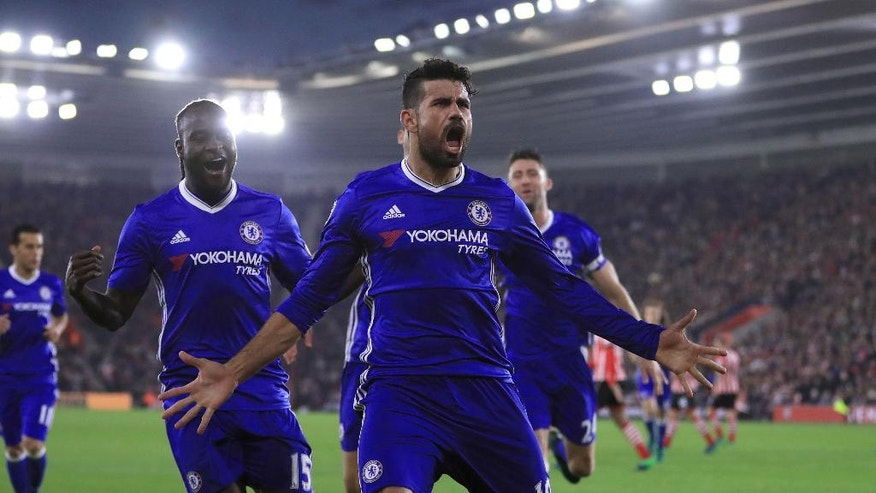 Chelsea's Diego Costa celebrates scoring his side's second goal against Southampton during their English Premier League soccer match at St Mary's Stadium in Southampton, England, Sunday Oct. 30, 2016. (John Walton / PA via AP)
