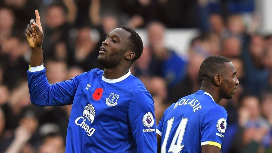 Everton's Romelu Lukaku, left, celebrates scoring his side's first goal during the English Premier League soccer match between Everton and West Ham United, at Goodison Park, in Liverpool, England, Sunday Oct. 30, 2016. (Dave Howarth/PA via AP)