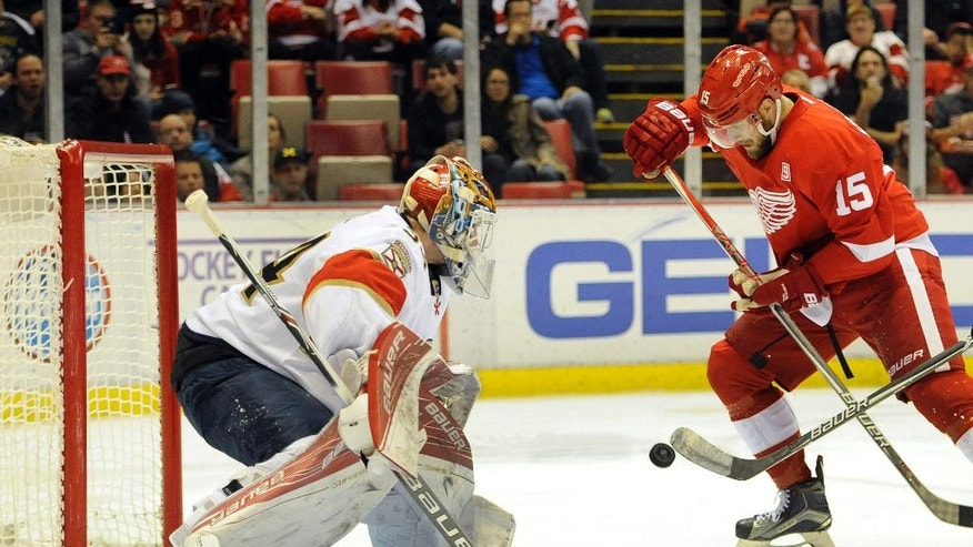 Detroit Red Wings center Riley Sheahan (15) prepares to shoot the puck on Florida Panthers goalie James Reimer (34) in the second period of an NHL hockey game in Detroit, Sunday, Oct. 30, 2016. (AP Photo/Jose Juarez)