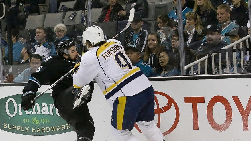Nashville Predators left wing Filip Forsberg (9), from Sweden, knocks down San Jose Sharks defenseman David Schlemko (5) during the second period of an NHL hockey game in San Jose, Calif., Saturday, Oct. 29, 2016. (AP Photo/Jeff Chiu)