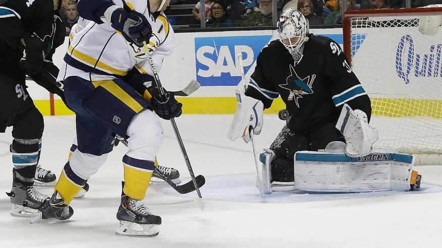 San Jose Sharks goalie Martin Jones (31) defends a shot from Nashville Predators right wing James Neal (18) during the second period of an NHL hockey game in San Jose, Calif., Saturday, Oct. 29, 2016. (AP Photo/Jeff Chiu)