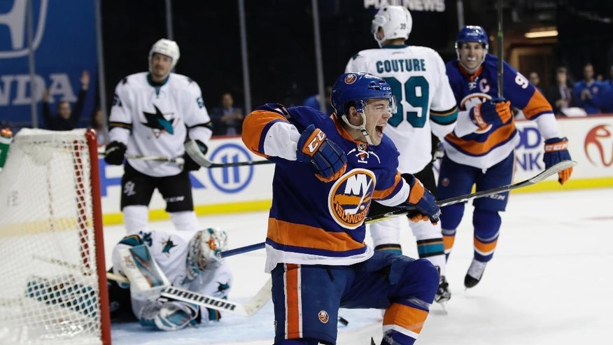 FILE - In this Oct. 18, 2016, file photo, New York Islanders' Anthony Beauvillier (72) celebrates after scoring his first career goal as San Jose Sharks goalie Aaron Dell gets up during the second period of an NHL hockey game in New York.  In the NFL and NBA, when you're drafted it's your turn to play, and MLB prospects almost always start in the minors, but NHL teams get the chance to test-run some of their top young prospects. After making their team's opening night NHL roster, those players are saddled with the uncertainty of another nine-game tryout, and decision time is near on many of them. (AP Photo/Frank Franklin II, File)
