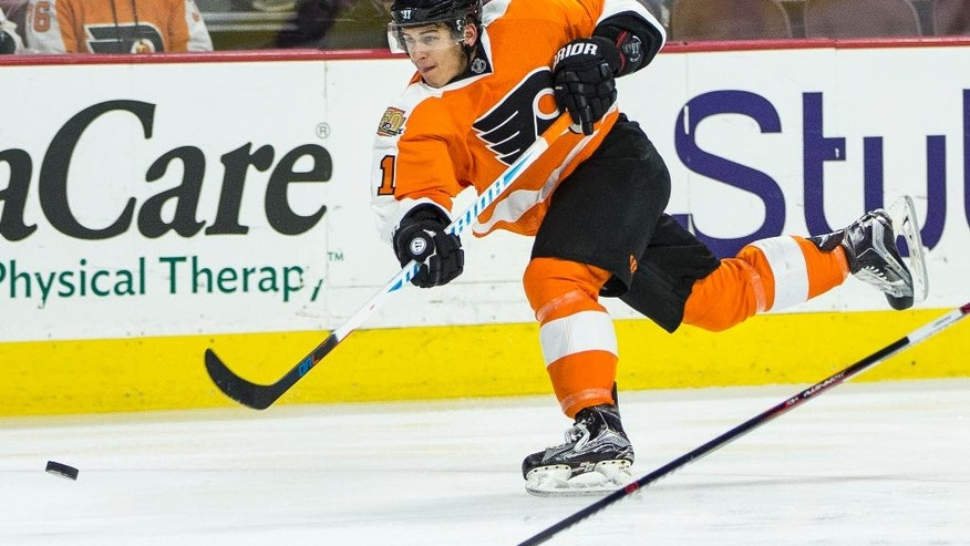 FILE - In this Oct. 22, 2016, file photo, Philadelphia Flyers' Travis Konecny shoots the puck during the second period of an NHL hockey game against Carolina Hurricanes, in Philadelphia.  In the NFL and NBA, when you're drafted it's your turn to play, and MLB prospects almost always start in the minors, but NHL teams get the chance to test-run some of their top young prospects. The  Flyers' approach was to take the test-run out of the equation entirely with 19-year-old Provorov, telling the 2015 first-round pick before opening night that they'd be around for the entire season.(AP Photo/Chris Szagola, File)