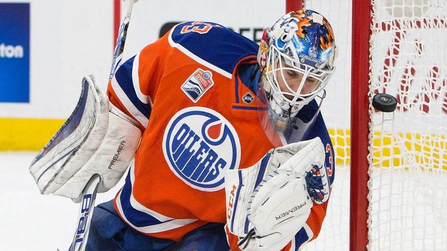 Edmonton Oilers goalie Cam Talbot (33) makes the save against the Ottawa Senators during first period NHL hockey action in Edmonton, Alberta, Sunday, Oct. 30, 2016. (Jason Franson/The Canadian Press via AP)