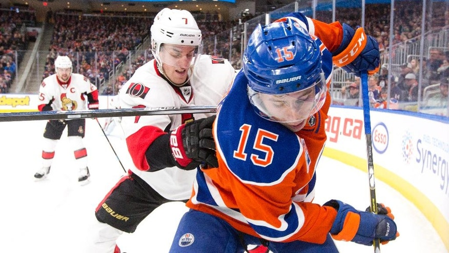 Ottawa Senators' Kyle Turris (7) and Edmonton Oilers' Tyler Pitlick (15) battle in the corner during second period NHL hockey action in Edmonton, Alberta, Sunday, Oct. 30, 2016. (Jason Franson/The Canadian Press via AP)