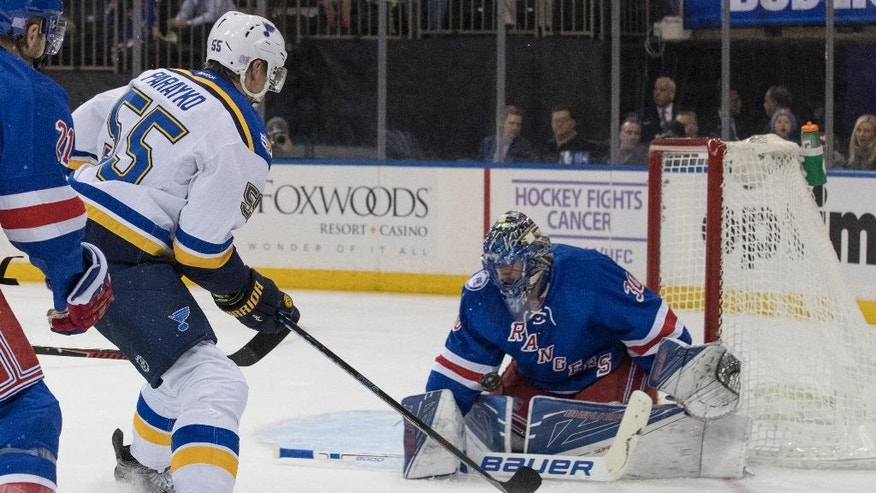 New York Rangers goalie Henrik Lundqvist (30) blocks a shot by St. Louis Blues defenseman Colton Parayko (55) during the first period of an NHL hockey game, Tuesday, Nov. 1, 2016, at Madison Square Garden in New York. (AP Photo/Mary Altaffer)