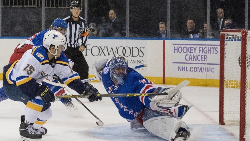 New York Rangers goalie Henrik Lundqvist (30) blocks a shot by St. Louis Blues center Robby Fabbri (15) during the first period of an NHL hockey game, Tuesday, Nov. 1, 2016, at Madison Square Garden in New York. (AP Photo/Mary Altaffer)