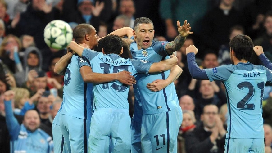 Manchester City's Aleksandar Kolarov, 2nd right, and his teammates celebrate their side's 3rd goal scored by Ilkay Gundogan during the Champions League group C soccer match between Manchester City and Barcelona at the Etihad stadium in Manchester, England, Tuesday, Nov. 1, 2016. (AP Photo/Rui Vieira)