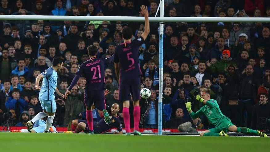 Manchester City's Ilkay Gundogan , left shoots and scores his sides third goal of the game during the Champions League group C soccer match between Manchester City and Barcelona at the Etihad stadium in Manchester, England, Tuesday, Nov. 1,2016. (AP Photo/Dave Thompson)