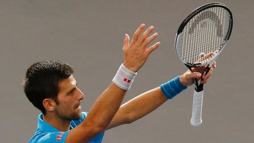Serbia's Novak Djokovic acknowledges applauses after the 2nd round of the Paris Masters tennis tournament at the Bercy Arena in Paris, Wednesday, Nov. 2, 2016. Djokovic won 6-3, 6-4. (AP Photo/Michel Euler)