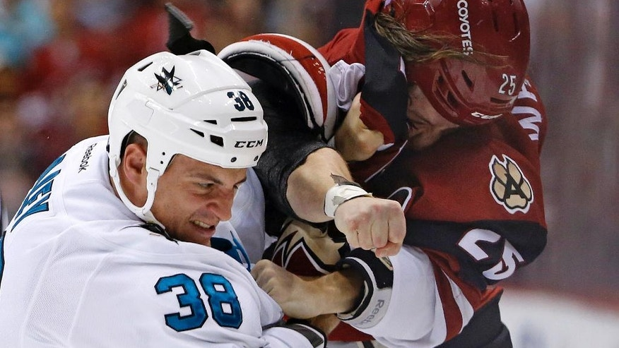 San Jose Sharks center Micheal Haley (38) gets into a fight with Arizona Coyotes center Ryan White (25) during the first period of an NHL hockey game Tuesday, Nov. 1, 2016, in Glendale, Ariz. (AP Photo/Ross D. Franklin)