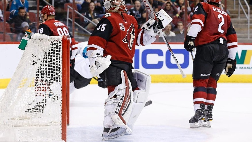 Arizona Coyotes' Louis Domingue (35) stands up after giving up a goal to San Jose Sharks left wing Patrick Marleau as Coyotes' defenseman Luke Schenn (2) and left wing Jamie McGinn (88) skate away during the first period of an NHL hockey game Tuesday, Nov. 1, 2016, in Glendale, Ariz. (AP Photo/Ross D. Franklin)