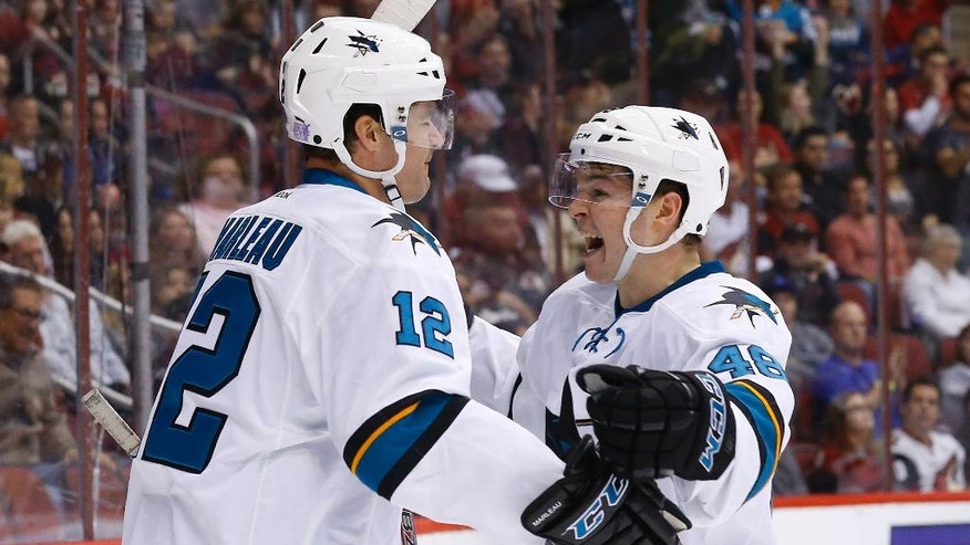 San Jose Sharks left wing Patrick Marleau (12) celebrates his goal against the Arizona Coyotes with center Tomas Hertl (48) during the first period of an NHL hockey game Tuesday, Nov. 1, 2016, in Glendale, Ariz. (AP Photo/Ross D. Franklin)