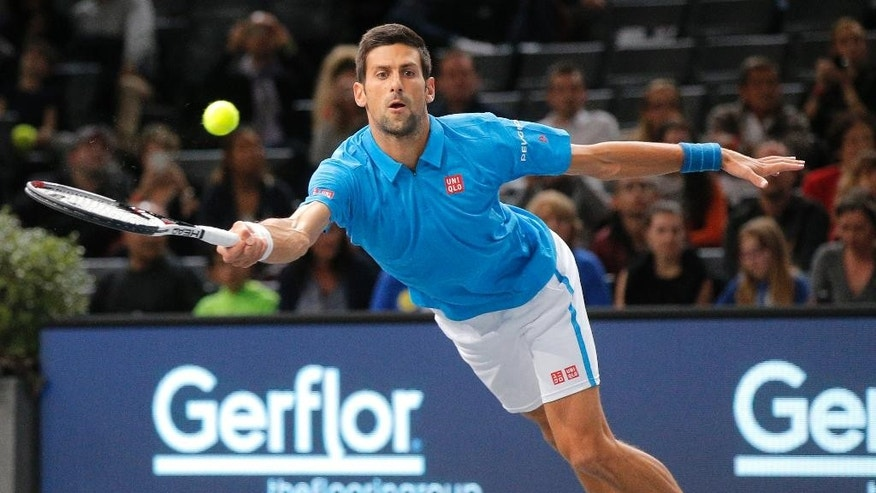 Serbia's Novak Djokovic returns the ball to Luxembourg's Gilles Muller during the 2nd round of the Paris Masters tennis tournament at the Bercy Arena in Paris, Wednesday, Nov. 2, 2016. (AP Photo/Michel Euler)