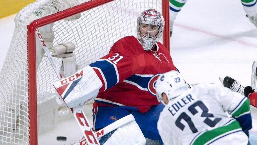 Vancouver Canucks defenseman Alexander Edler is stopped by Montreal Canadiens goalie Carey Price during the second period of an NHL hockey game Wednesday, Nov. 2, 2016, in Montreal. (Ryan Remiorz/The Canadian Press via AP)