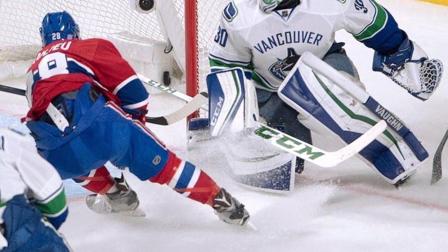 Montreal Canadiens defenseman Nathan Beaulieu scores against Vancouver Canucks goalie Ryan Miller during the second period of an NHL hockey game Wednesday, Nov. 2, 2016, in Montreal. (Ryan Remiorz/The Canadian Press via AP)