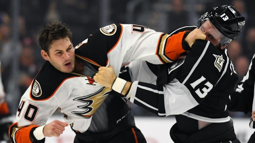 Anaheim Ducks right wing Jared Boll, left, and Los Angeles Kings left wing Kyle Clifford fight during the first period of an NHL hockey game, Tuesday, Nov. 1, 2016, in Los Angeles. (AP Photo/Mark J. Terrill)