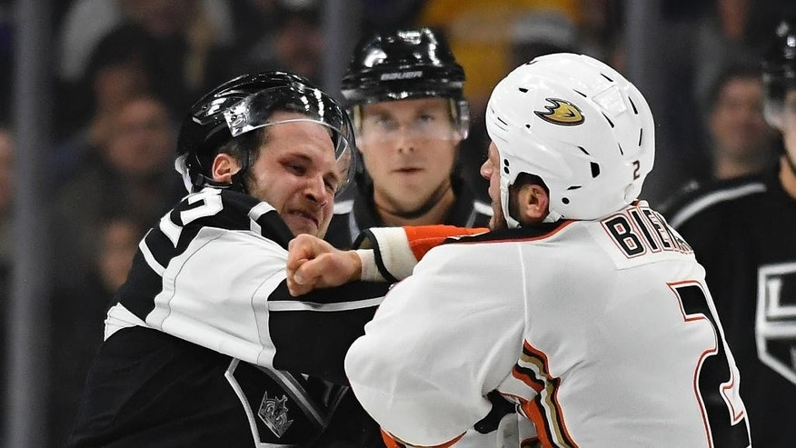 Los Angeles Kings left wing Kyle Clifford, left, and Anaheim Ducks defenseman Kevin Bieksa fight during the first period of an NHL hockey game, Tuesday, Nov. 1, 2016, in Los Angeles. (AP Photo/Mark J. Terrill)