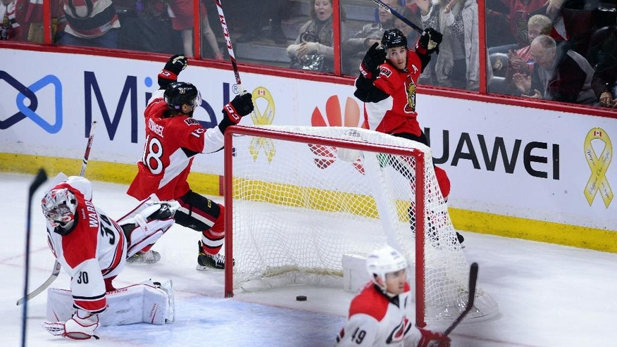 Ottawa Senators' Kyle Turris, back right, celebrates his game winning overtime goal against the Carolina Hurricanes during an NHL hockey game in Ottawa, Tuesday, Nov. 1, 2016. The Senators won 2-1 in overtime. (Sean Kilpatrick/The Canadian Press via AP)