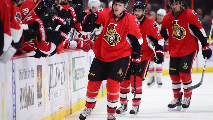 Ottawa Senators' Dion Phaneuf celebrates with teammates after scoring against the Carolina Hurricanes during the first period of an NHL hockey game in Ottawa, Tuesday, Nov. 1, 2016. (Sean Kilpatrick/The Canadian Press via AP)