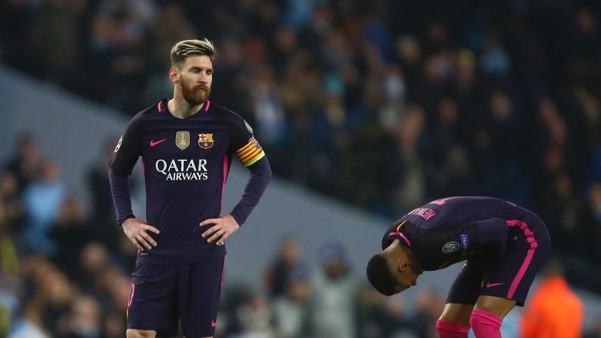 Barcelona's Lionel Messi, left and teammate Barcelona's Neymar react after the end of the Champions League group C soccer match between Manchester City and Barcelona at the Etihad stadium in Manchester, England, Tuesday, Nov. 1, 2016. City won the game 3-1. (AP Photo/Dave Thompson)