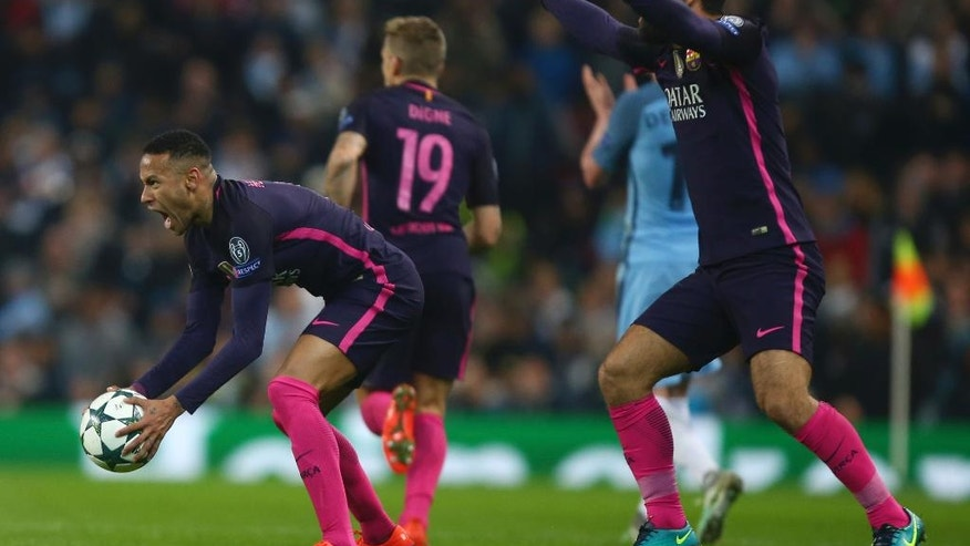 Barcelona's Neymar, left, reacts to a decision by the referee during the Champions League group C soccer match between Manchester City and Barcelona at the Etihad stadium in Manchester, England, Tuesday, Nov. 1,2016. (AP Photo/Dave Thompson)