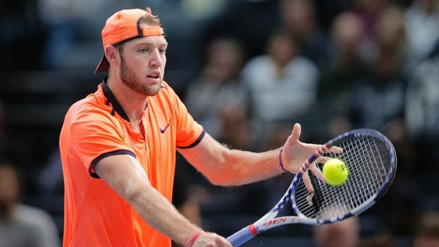 Jack Sock of the United States returns the ball to Richard Gasquet of France during the 3rd round of the Paris Masters tennis tournament at the Bercy Arena in Paris, Thursday, Nov. 3, 2016. (AP Photo/Michel Euler)