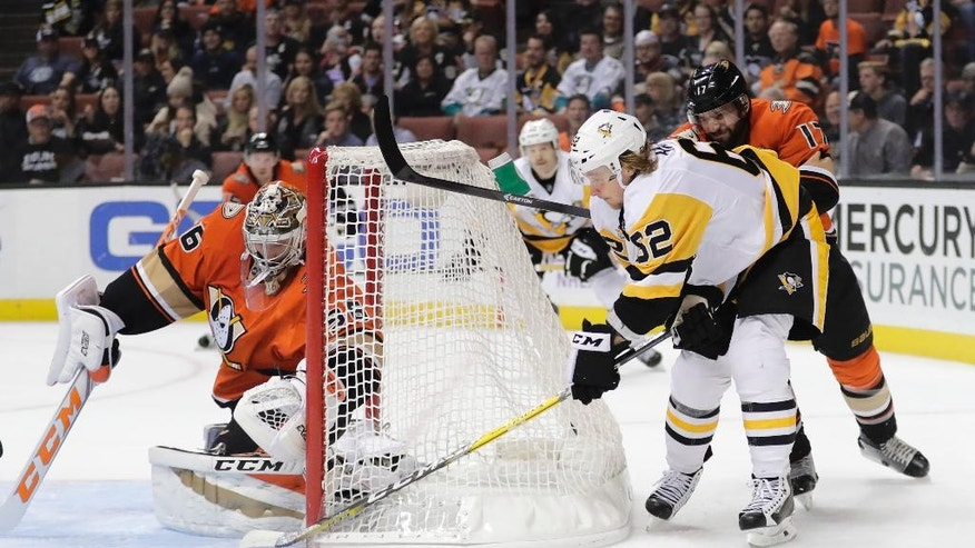 Pittsburgh Penguins' Carl Hagelin (62), of Sweden, moves the puck under pressure from Anaheim Ducks' Ryan Kesler (17) behind Ducks goalie John Gibson during the first period of an NHL hockey game Wednesday, Nov. 2, 2016, in Anaheim, Calif. (AP Photo/Jae C. Hong)