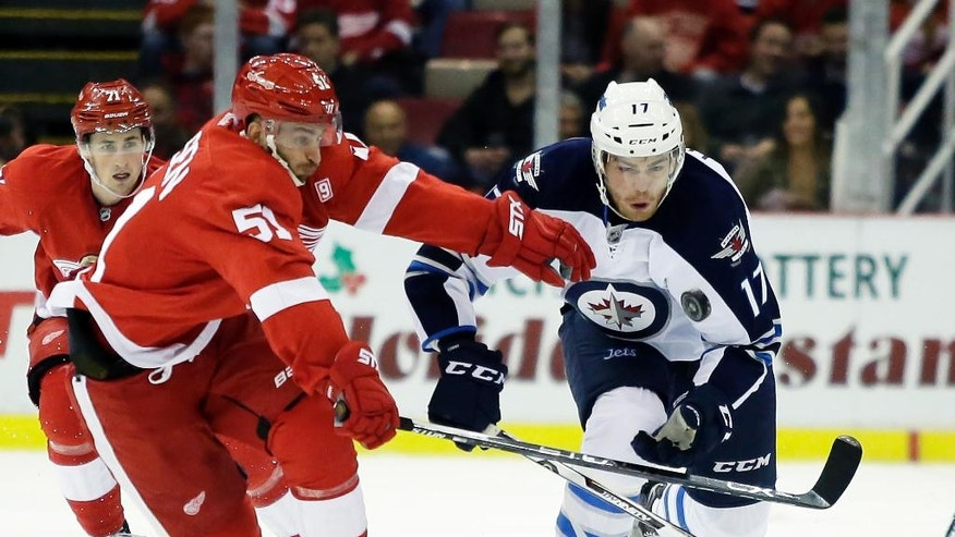Detroit Red Wings center Frans Nielsen (51), of Denmark, tries to chase down the puck against Winnipeg Jets center Adam Lowry (17) during the first period of an NHL hockey game Friday, Nov. 4, 2016, in Detroit. (AP Photo/Duane Burleson)