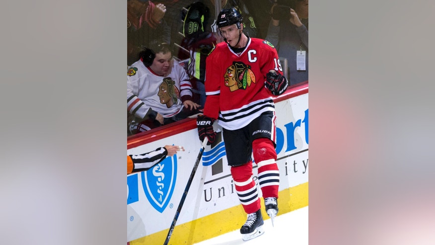 Chicago Blackhawks center Jonathan Toews celebrates after scoring a goal during the first period of an NHL hockey game against the Colorado Avalanche in Chicago, Thursday, Nov. 3, 2016. (AP Photo/Nam Y. Huh)