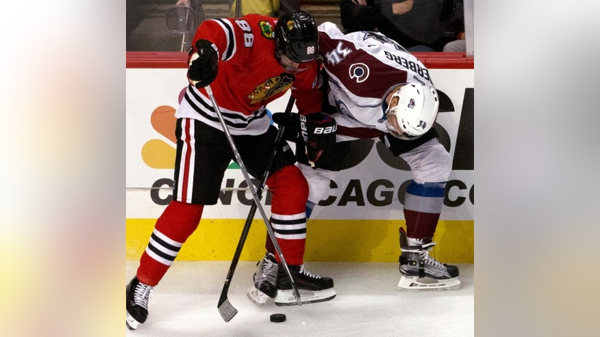 Chicago Blackhawks right wing Patrick Kane, left and Colorado Avalanche center Carl Soderberg battle for the puck during the first period of an NHL hockey game in Chicago, Thursday, Nov. 3, 2016. (AP Photo/Nam Y. Huh)