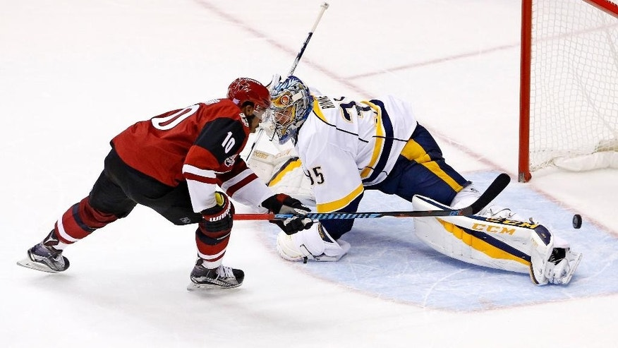 Arizona Coyotes left wing Anthony Duclair (10) scores against Nashville Predators goalie Pekka Rinne, right, during the shootout of an NHL hockey game Thursday, Nov. 3, 2016, in Glendale, Ariz. The Coyotes 3-2. (AP Photo/Ross D. Franklin)
