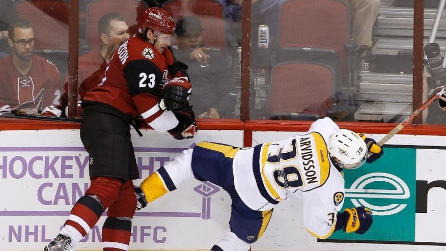 Arizona Coyotes defenseman Oliver Ekman-Larsson (23) checks Nashville Predators left wing Viktor Arvidsson (38) to the ice during the third period of an NHL hockey game Thursday, Nov. 3, 2016, in Glendale, Ariz. The Coyotes defeated the Predators 3-2 in a shootout. (AP Photo/Ross D. Franklin)