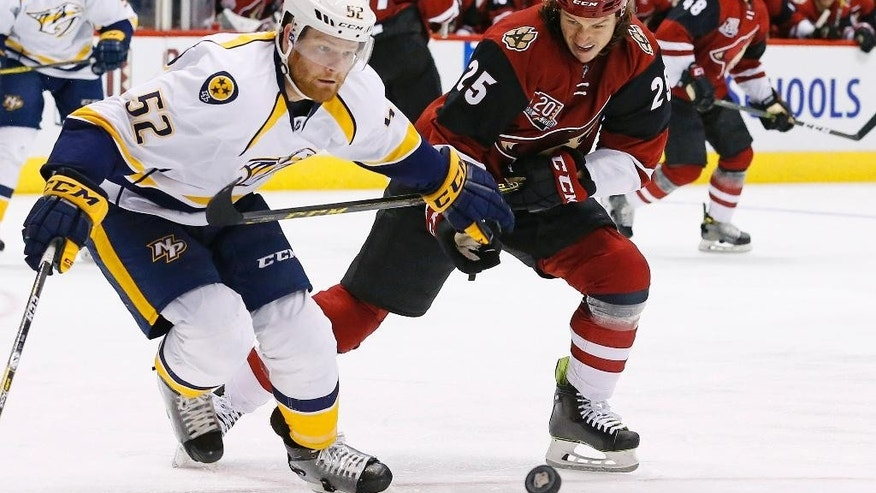 Nashville Predators defenseman Matt Irwin (52) and Arizona Coyotes center Ryan White (25) skate after the puck during the second period of an NHL hockey game Thursday, Nov. 3, 2016, in Glendale, Ariz. (AP Photo/Ross D. Franklin)