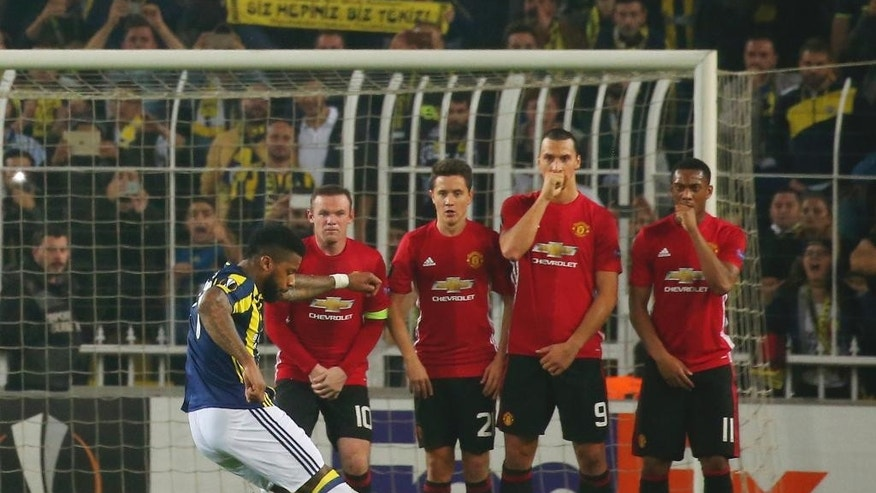 Fenerbahce Jeremain Lens shoots to score against Manchester United, during a Europa League group A soccer match between Fenerbahce and Manchester United, in Istanbul, Thursday, Nov. 3, 2016. Fenerbahce won the match 2-1. (AP Photo)