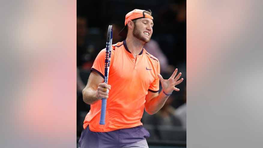 Jack Sock of the United States reacts after loosing a point against John Isner of the United States in the quarterfinal match of the Paris Masters tennis tournament at the Bercy Arena in Paris, Friday, Nov. 4, 2016. (AP Photo/Michel Euler)