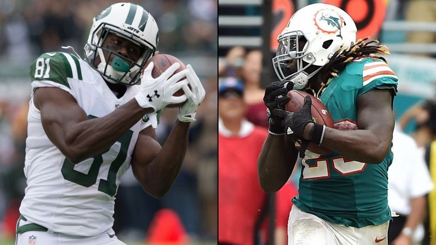 <p>New York Jets wide receiver Quincy Enunwa (left) and Miami Dolphins running back Jay Ajayi (right).<br> </p>