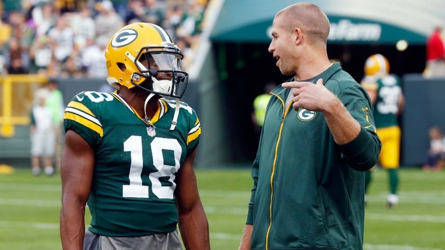<p>Green Bay Packers' Jordy Nelson talks to Randall Cobb (18) before a preseason NFL football game against the Philadelphia Eagles Saturday, Aug. 29, 2015, in Green Bay, Wis. (AP Photo/Mike Roemer)</p>