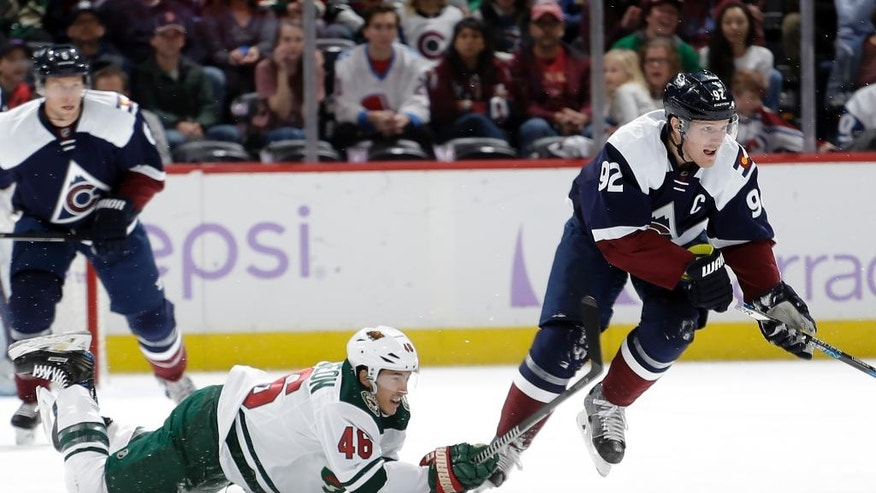Minnesota Wild defenseman Jared Spurgeon (46) falls to the ice while chasing Colorado Avalanche left wing Gabriel Landeskog (92) during the first period of an NHL hockey game, Saturday, Nov. 5, 2016, in Denver. (AP Photo/Jack Dempsey)