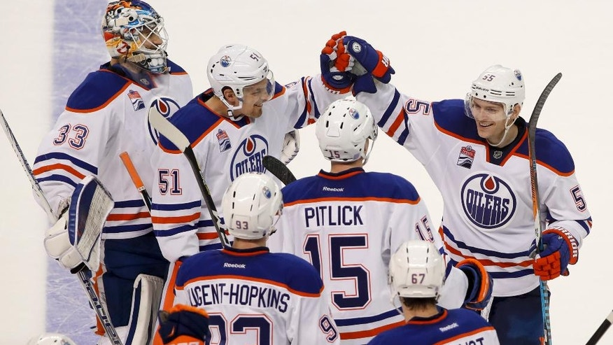 Edmonton Oilers center Mark Letestu (55) celebrates with teammates after scoring the winning goal against the New York Islanders during a shootout of an NHL hockey game, Saturday, Nov. 5, 2016, in New York. The Oilers won 4-3. (AP Photo/Julie Jacobson)