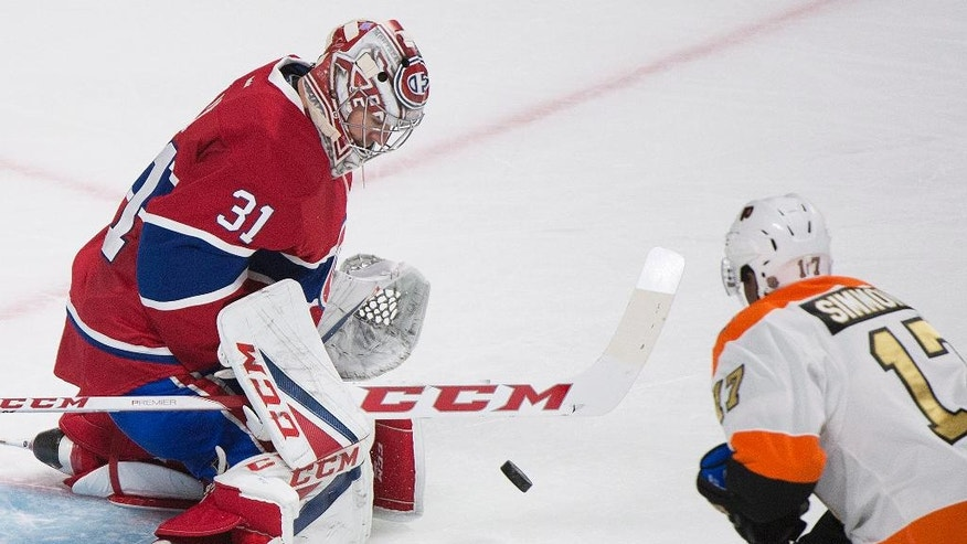 CORRECTS DATE Montreal Canadiens goaltender Carey Price makes a save against Philadelphia Flyers' Wayne Simmonds during second period NHL hockey action in Montreal, Saturday, Nov. 5, 2016. (Graham Hughes/The Canadian Press via AP)