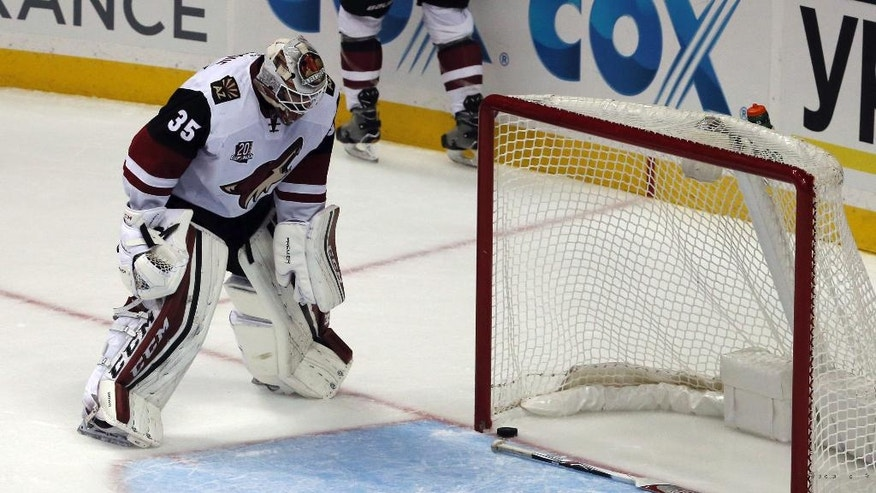 Arizona Coyotes goalie Louis Domingue (35) drops his stick and stares at the puck after the Anaheim Ducks' second goal by center Rickard Rakell during the first period of an NHL hockey game in Anaheim, Calif., Friday, Nov. 4, 2016. (AP Photo/Reed Saxon)