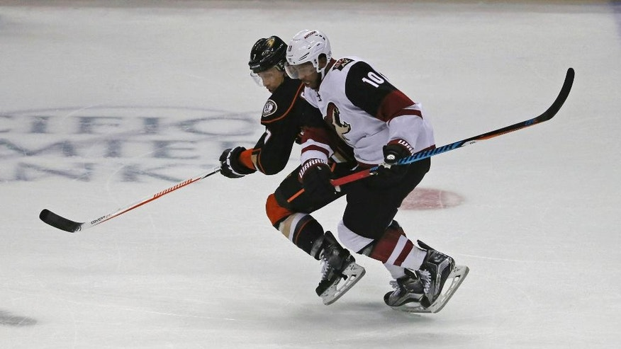 Arizona Coyotes left winger Anthony Duclair (10) and Anaheim Ducks left winger Andrew Cogliano (7) chase the puck in the first period of an NHL hockey game in Anaheim, Calif., Friday, Nov. 4, 2016. (AP Photo/Reed Saxon)