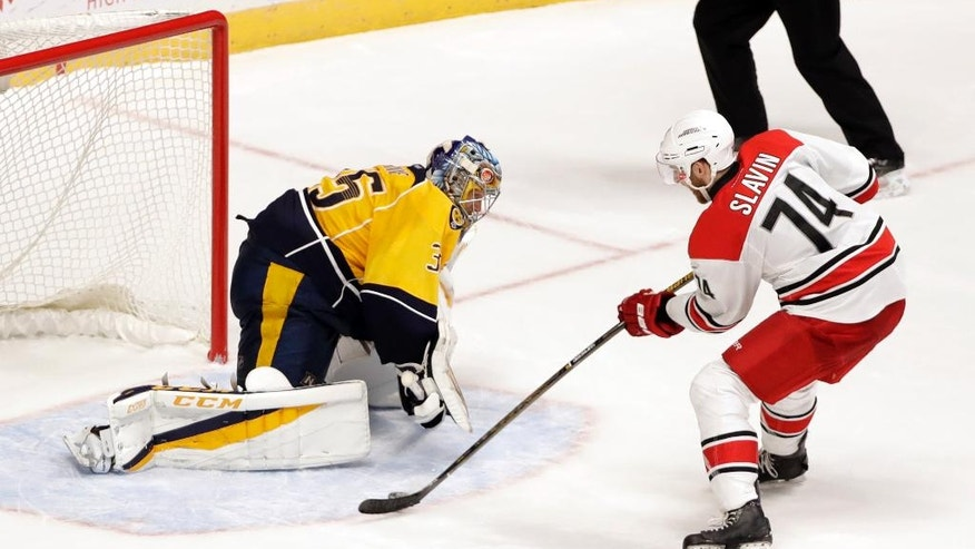 Carolina Hurricanes defenseman Jaccob Slavin (74) scores the winning goal against Nashville Predators goalie Pekka Rinne (35), of Finland, during a shootout at an NHL hockey game Saturday, Nov. 5, 2016, in Nashville, Tenn. (AP Photo/Mark Humphrey)