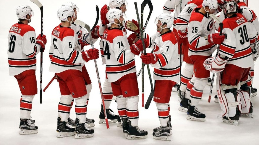 Carolina Hurricanes defenseman Jaccob Slavin (74) celebrates with teammates after scoring the winning goal against the Nashville Predators during a shootout at an NHL hockey game Saturday, Nov. 5, 2016, in Nashville, Tenn.  (AP Photo/Mark Humphrey)