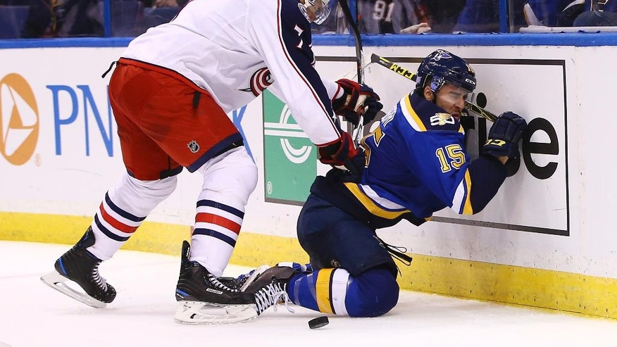 St. Louis Blues' Robby Fabbri, right, is checked into the boards by Columbus Blue Jackets' Jack Johnson during the second period of an NHL hockey game Saturday, Nov. 5, 2016, in St. Louis. (AP Photo/Billy Hurst)