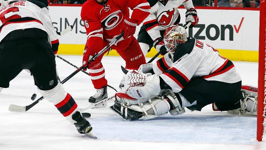 Carolina Hurricanes' Elias Lindholm (16) has his shot blocked by New Jersey Devils goalie Keith Kinkaid (1) during the second period of an NHL hockey game, Sunday, Nov. 6, 2016, in Raleigh, N.C. (AP Photo/Karl B DeBlaker)