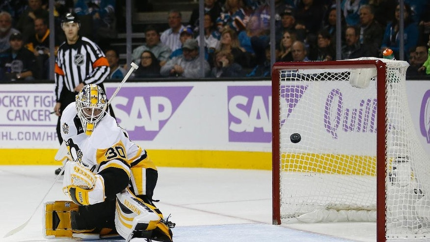 Pittsburgh Penguins goalie Matt Murray (30) looks back as a puck bounces off the pole a goal attempt by San Jose Sharks during the first period of an NHL hockey game Saturday, Nov. 5, 2016, in San Jose, Calif. (AP Photo/Tony Avelar)
