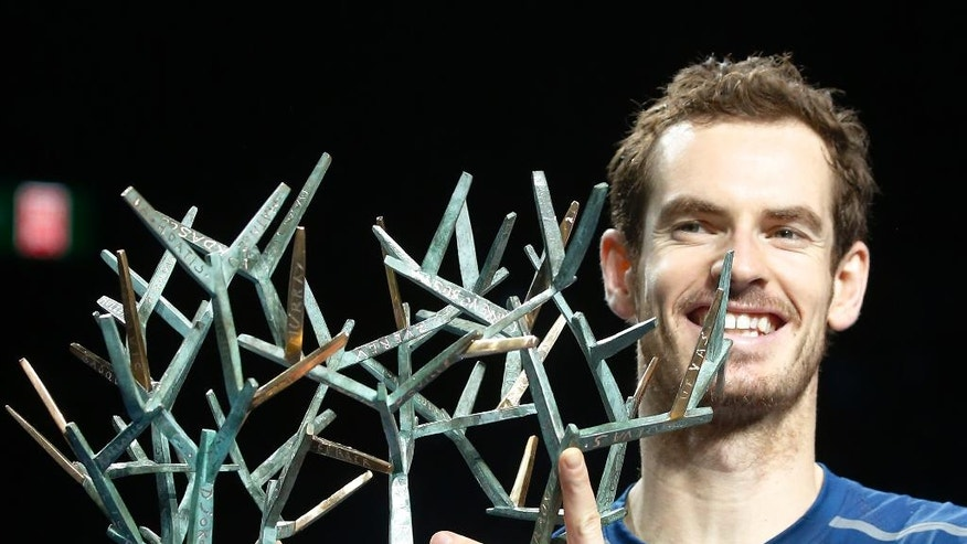 Britain's Andy Murray holds the trophy after winning the final of the Paris Masters tennis tournament against John Isner of the United States in three sets 6-3, 6-7, 6-4 at the Bercy Arena in Paris, Sunday, Nov. 6, 2016. (AP Photo/Michel Euler)